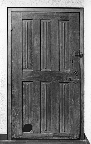 A door with a cat hole dating from around 1450-1500.