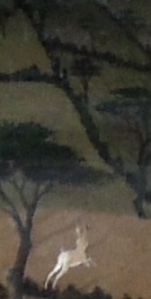 A hare leaping towards some trees. A detail from a painting by Paolo Uccello (c1397-1475)