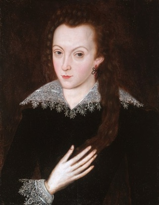 A youth in a black doublet with a wide lace collar. He has his hand on his heart.