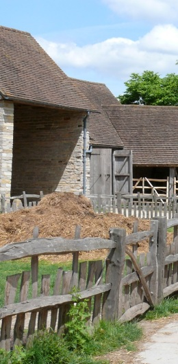 16th century farm buildings, with a pile of hay.