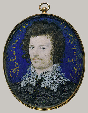 Head and shoulders of a young man with dark curly hair and a slight moustach, against a blue background.