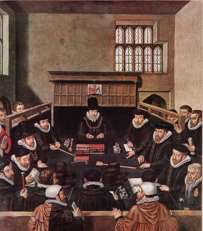 A group of men in dark suits with white ruffs seated around a table. Lord Burghley is at the head. There are some onlookers behind partitions.
