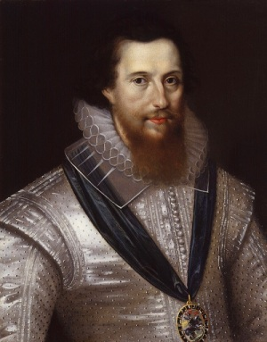 A dark-haired young man with a spade-shaped beard, He's wearing a glossy white satin doublet.