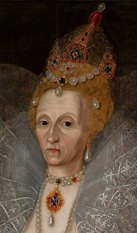An elegant but weary looking woman in silvery white, wearing magnificent jewels,