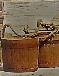 Two wooden buckets with handles made of rope.