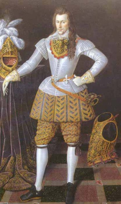 A long-haired young man in a white silk doublet with gold and purple trunkhose, white silk stockings and black shoes. He's also wearing a black and gold gorget, and a plumed helmet and breastplate are nearby.