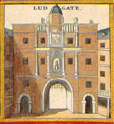 A large three-storey brick building, built over an archway with a portcullis.