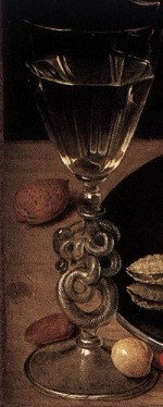 A wine glass on a table.