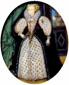 A full length portrait of a dark-eyed, fair-haired woman.