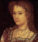 A dark-eyed young woman with loosely arranged reddish gold hair.
