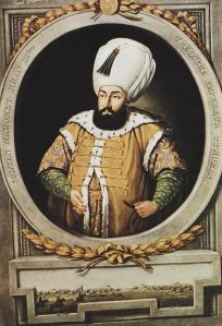 The imposing figure of a dark-bearded man wearing a very large white turban.