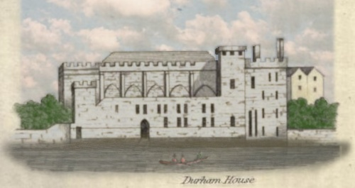 A large, grey stone building with crenellations.