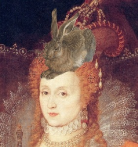 Elizabeth I with a live hare on top of her curled red wig.