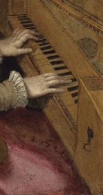 A woman's hands on the keys of a spinet.