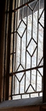 An Ekizabethan paned window with a wintry outlook.
